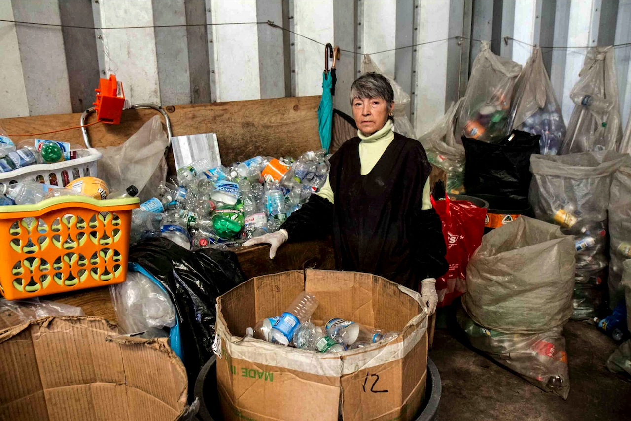 Maria Angelica sorts bottles at the Sure We Can facility (Photo by Michael Premo)