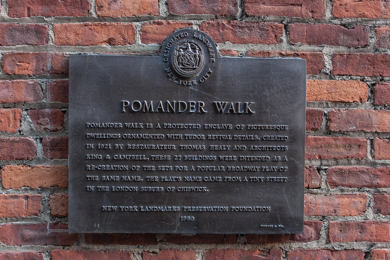 Sign stating Pomander Walk's status as a designated NYC landmark