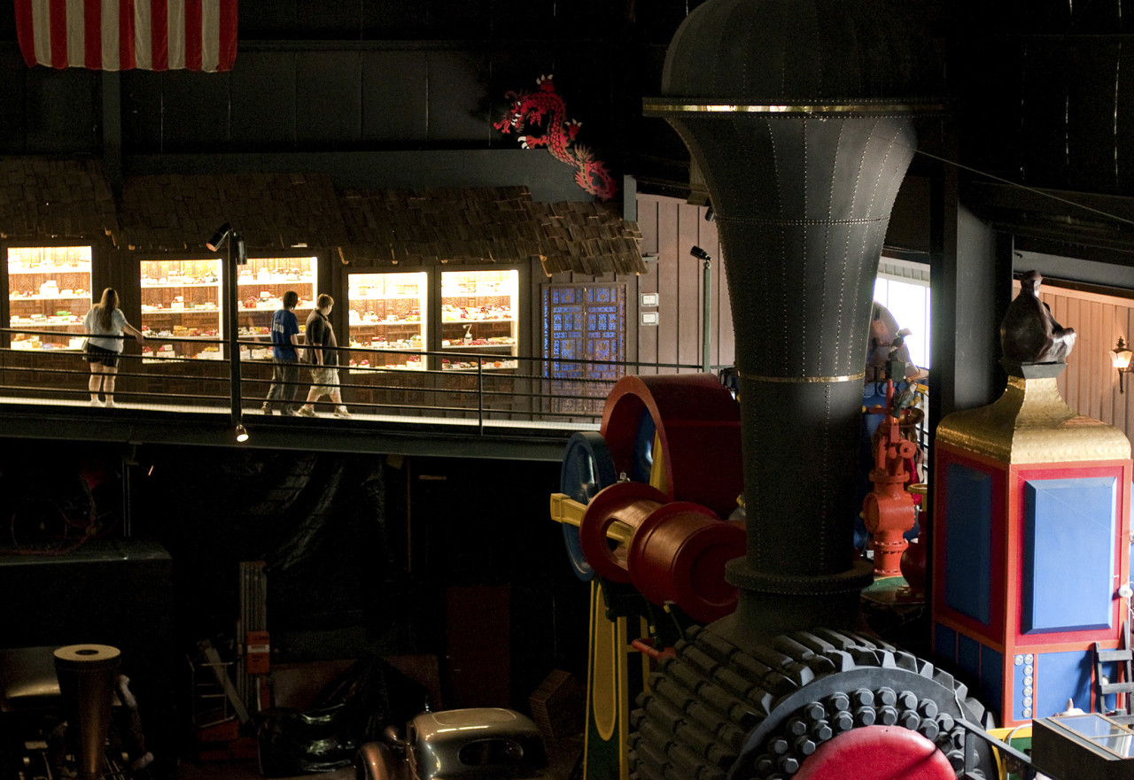Visitors explore the upper level of the large automobile room at the House on the Rock.