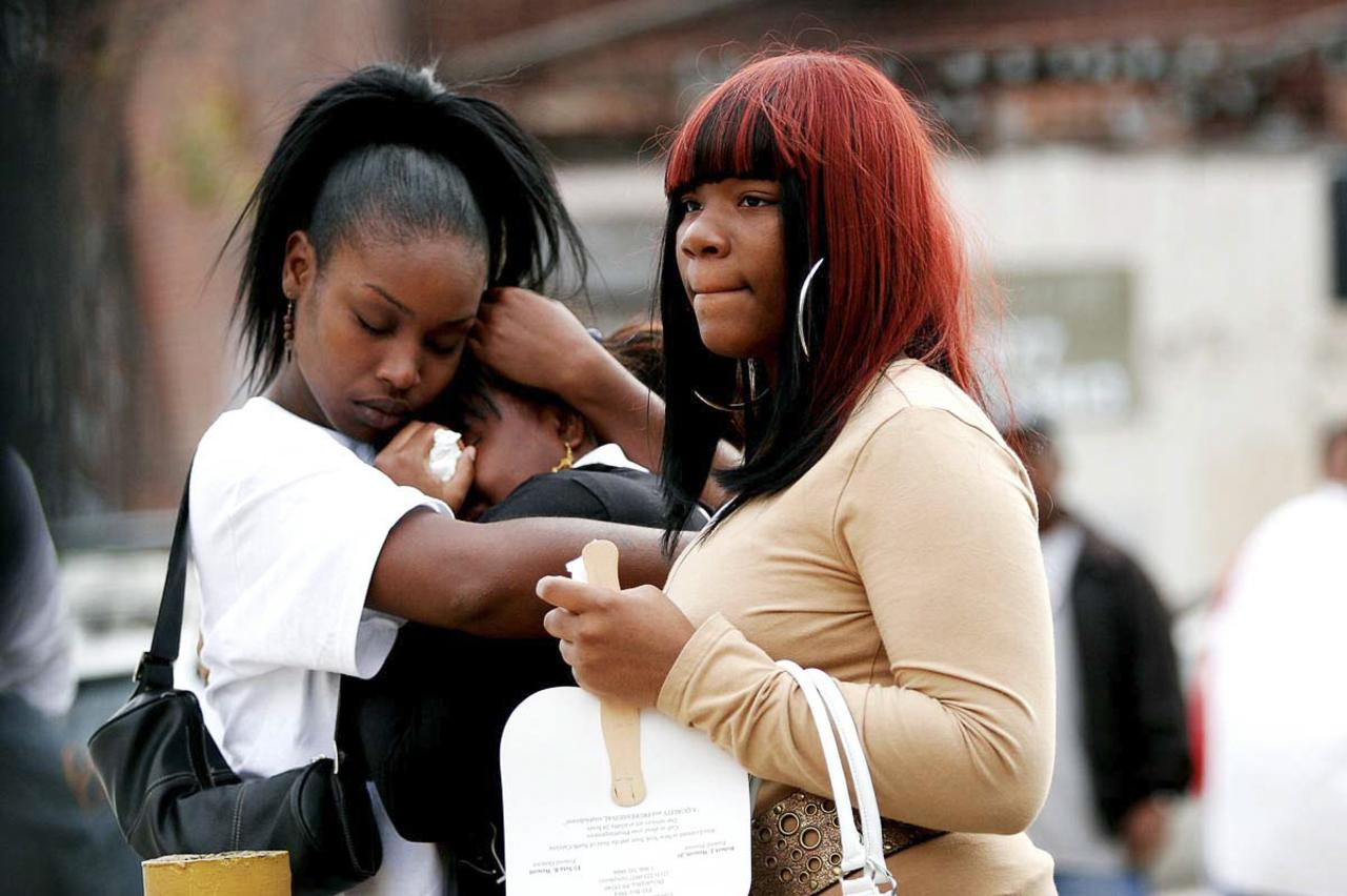 Family gather to mourn at a funeral in Philadelphia on September 29, 2006. (© John Taggart/Narratively 2013)