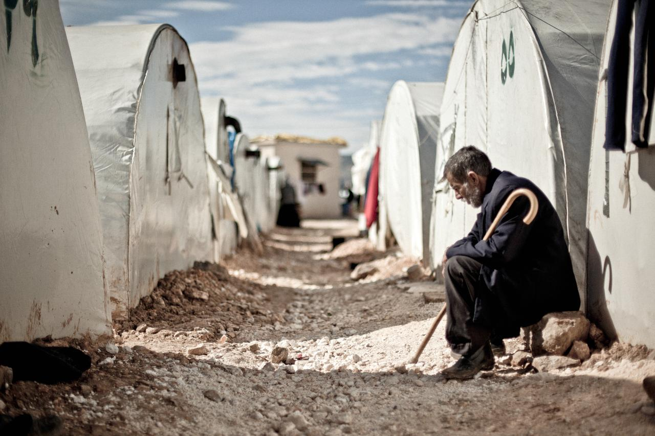 A man sits outside his tent in the Bab al-Salam refugee camp on the Syria-Turkey border.