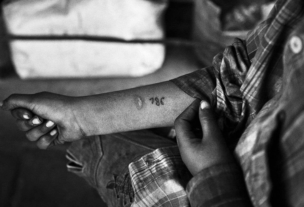 """Mushraf proudly shows off the tattoo on the forearm. In Basmala numerology, the figure """"786"""" stands for """"in the Name of Allah,"""" a sign of protection. He got the tattoo two years ago as a blessing and sign of devotion, although he is not a practicing Muslim anymore."""