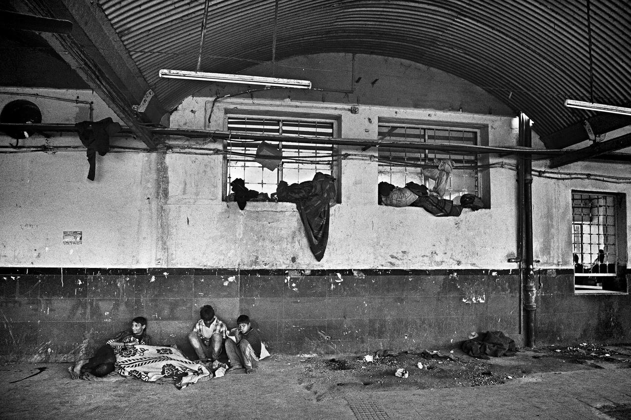 A gang of street children sleeping in the railway station, surrounded by their meager belongings, often made only of few blankets and sweaters. Neglected by family and society, street children never sleep alone. The gang becomes their family, their only reference, support and protection.