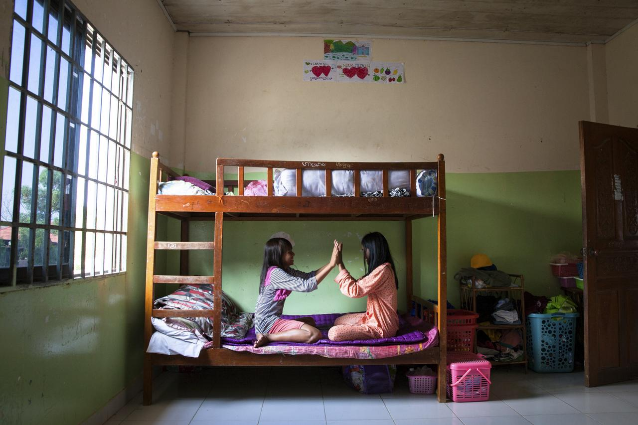 Girls play in their bedroom at CCPCR's shelter.