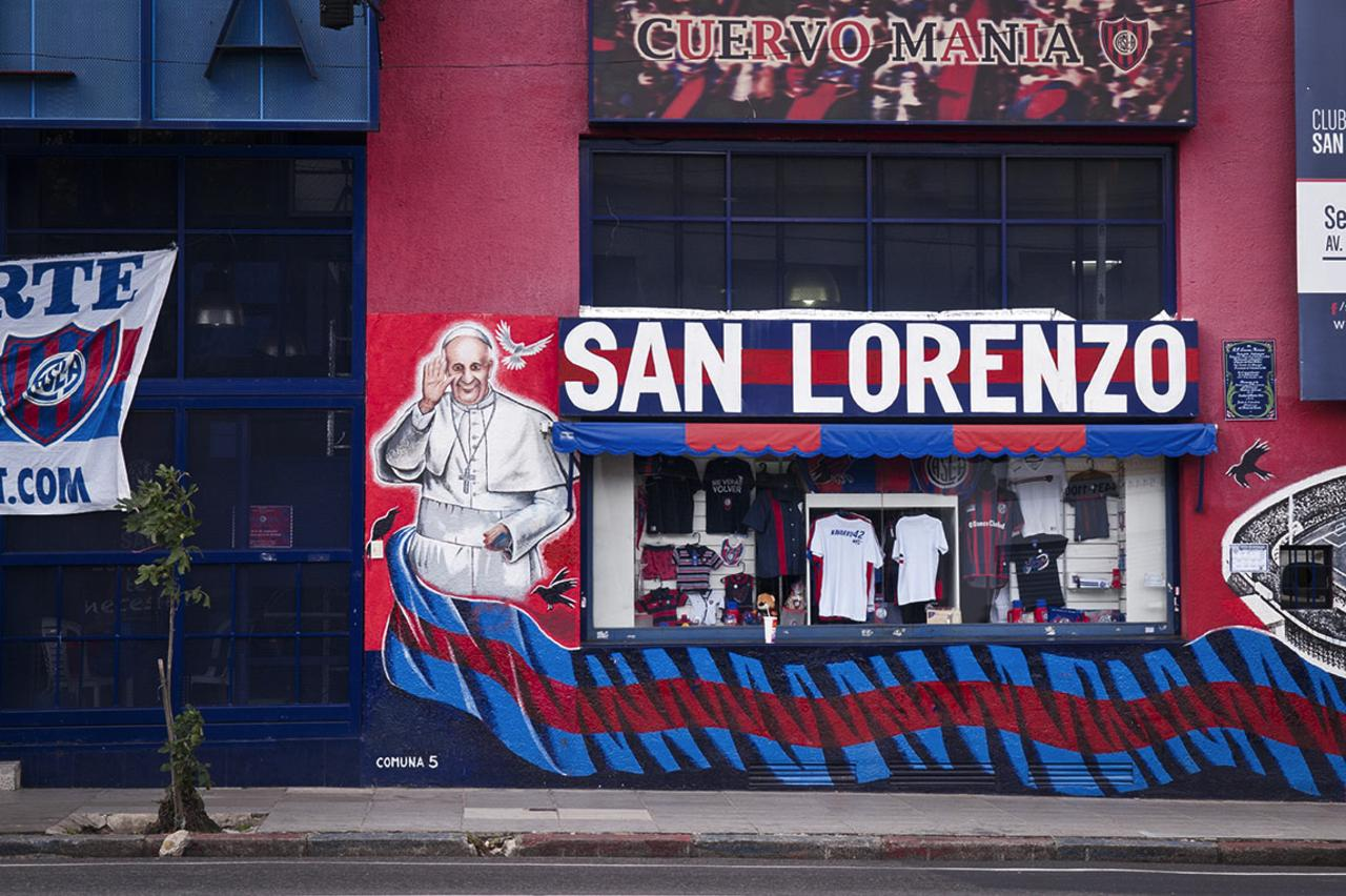 Pope Francis is featured in a mural supporting the team.