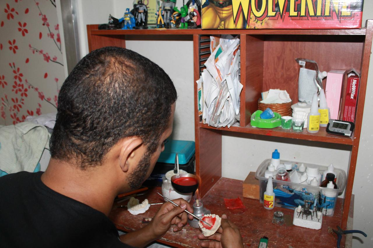 Melo at work in his teeth-making workshop. (Photo by Tracy Lee)