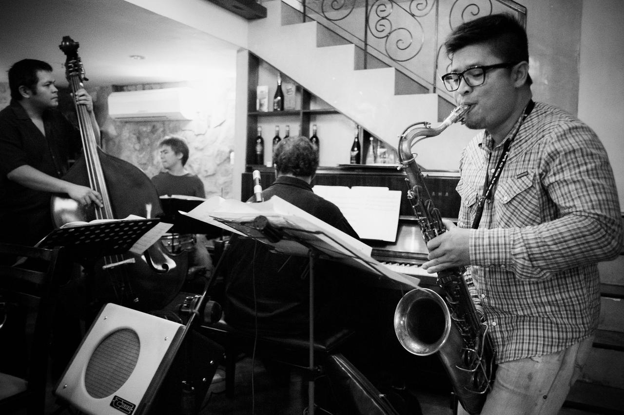 Bassist Dave Harder, drummer Rey Vinoya, pianist Mel Santos, and saxophonist Alvin Cornista play a set at Trattoria Poggio Antico in McKinley Hill, Manila.