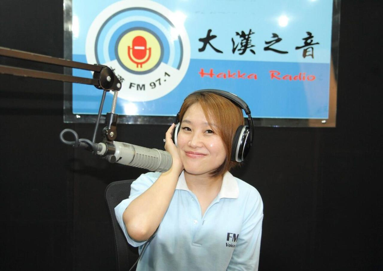 "At the 97.1 FM Hakka radio station, DJ Yin Chang runs ""Henai,"" an evening Hakka language program, and ""Multivitamin,"" a night Mandarin language program aimed at youth. As a DJ, Chang works to promote the Hakka language, Hakka music and rising Hakka musicians. (Photo courtesy of DJ Yin Chang)"