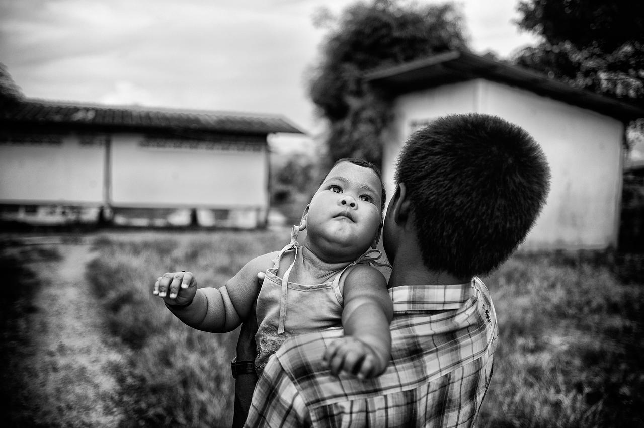 With her physical deformity removed, Than Zin Moe is carried like a normal baby by her father U Nay. The family is about to leave the Mae Tao Clinic to travel back to Myanmar.