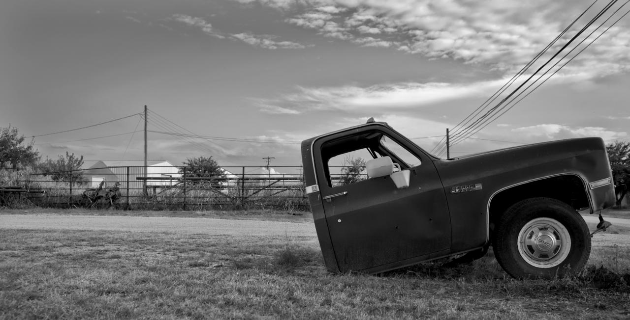 A sundered GMC Sierra Classic rested in a field in Archer City, Texas, on July 27, 2010. Photo by Danny Fulgencio