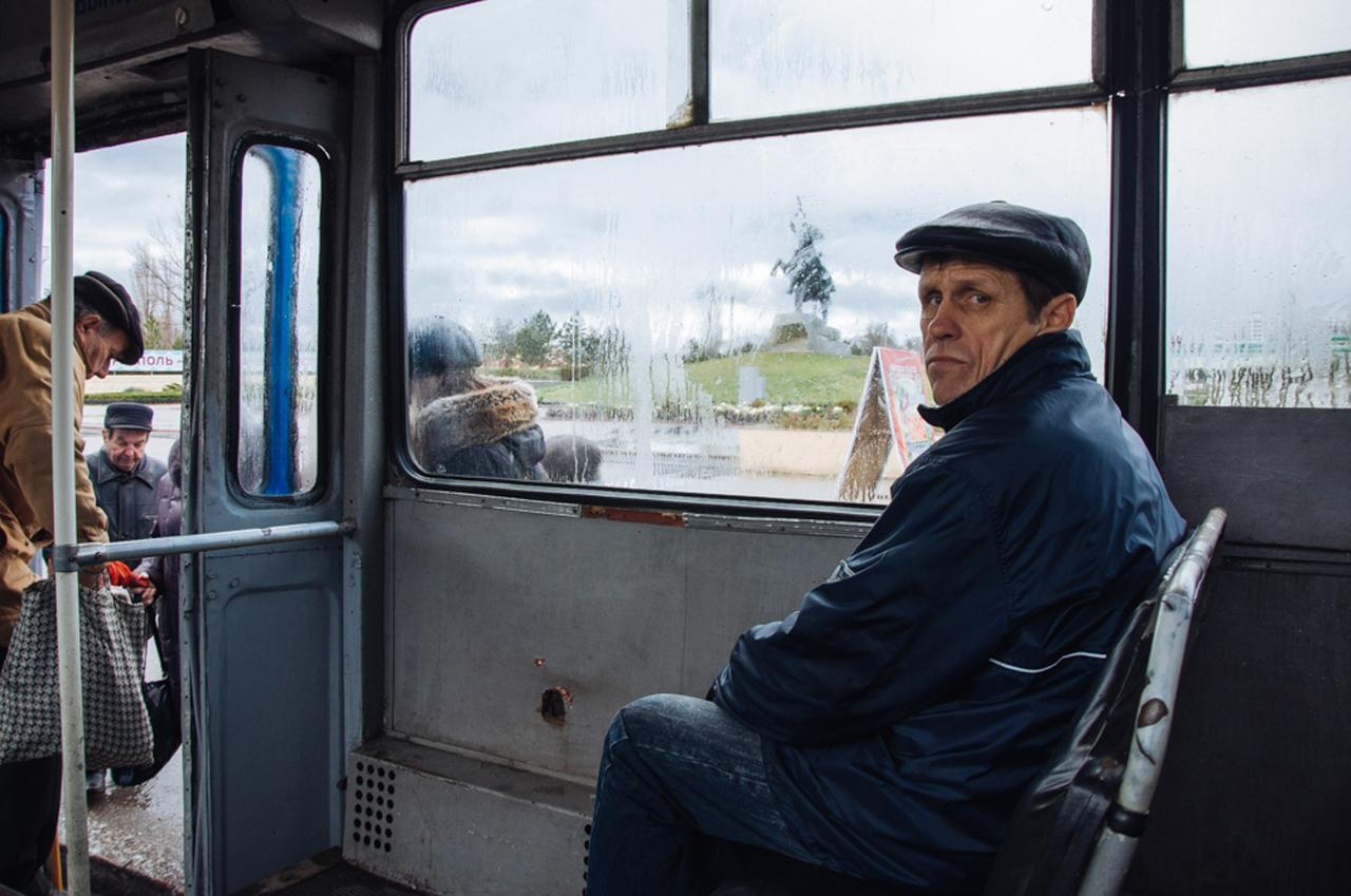 Alexander Veryovkin, a famous Soviet footballer, on a bus in the city of Tiraspol. The bus is Number 19, named for June 19, the day the conflict began between Moldova and Transnistria.