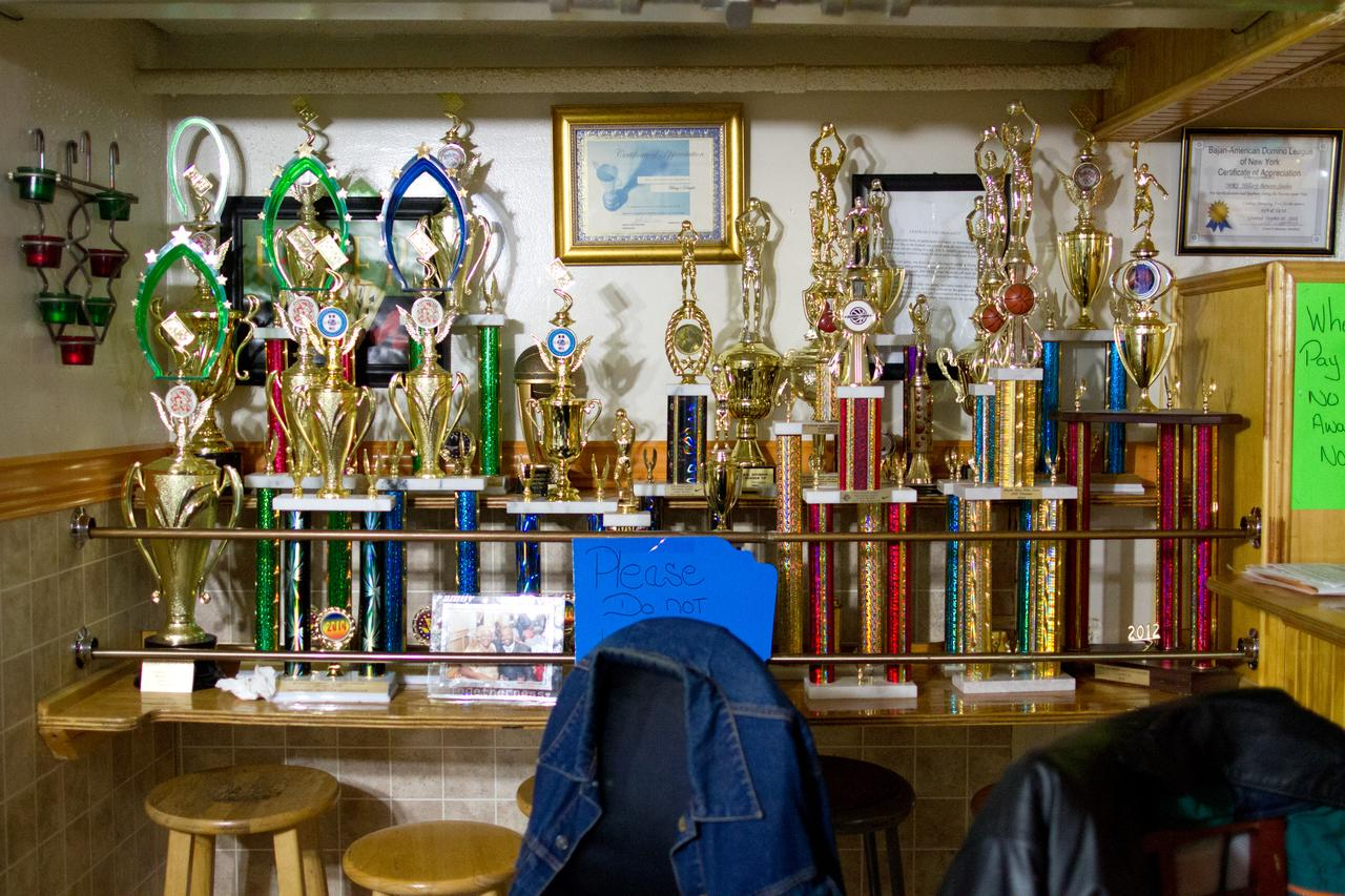 The trophy wall at Hilary's Delights. On the right are Hilary Bowen's son's basketball trophies. On the left, trophies from the Bajan Caribbean Domino League.