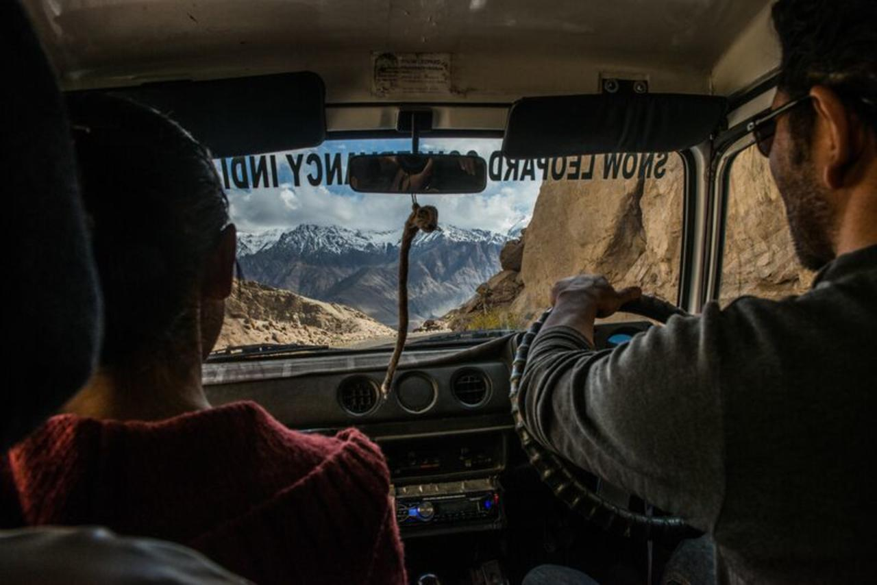 Namgail driving the jeep on a rough mountain road through the Himalayas in Ladakh.
