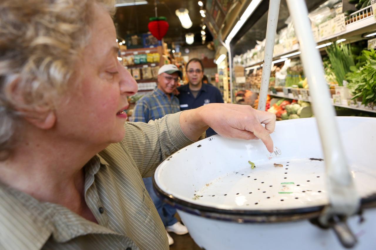 Mariette Mogannam inspects the produce scale at Bi-Rite Market.