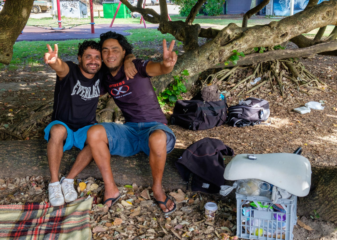 Two indigenous men sharing a New Years Eve drink while camping in Railway Park.