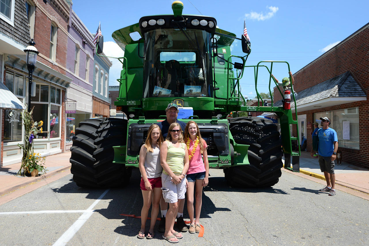 The Anderson family pose beside their combine. Kevin Anderson owns Wimberly Farms in Princess Anne, 30 miles from Snow Hill.