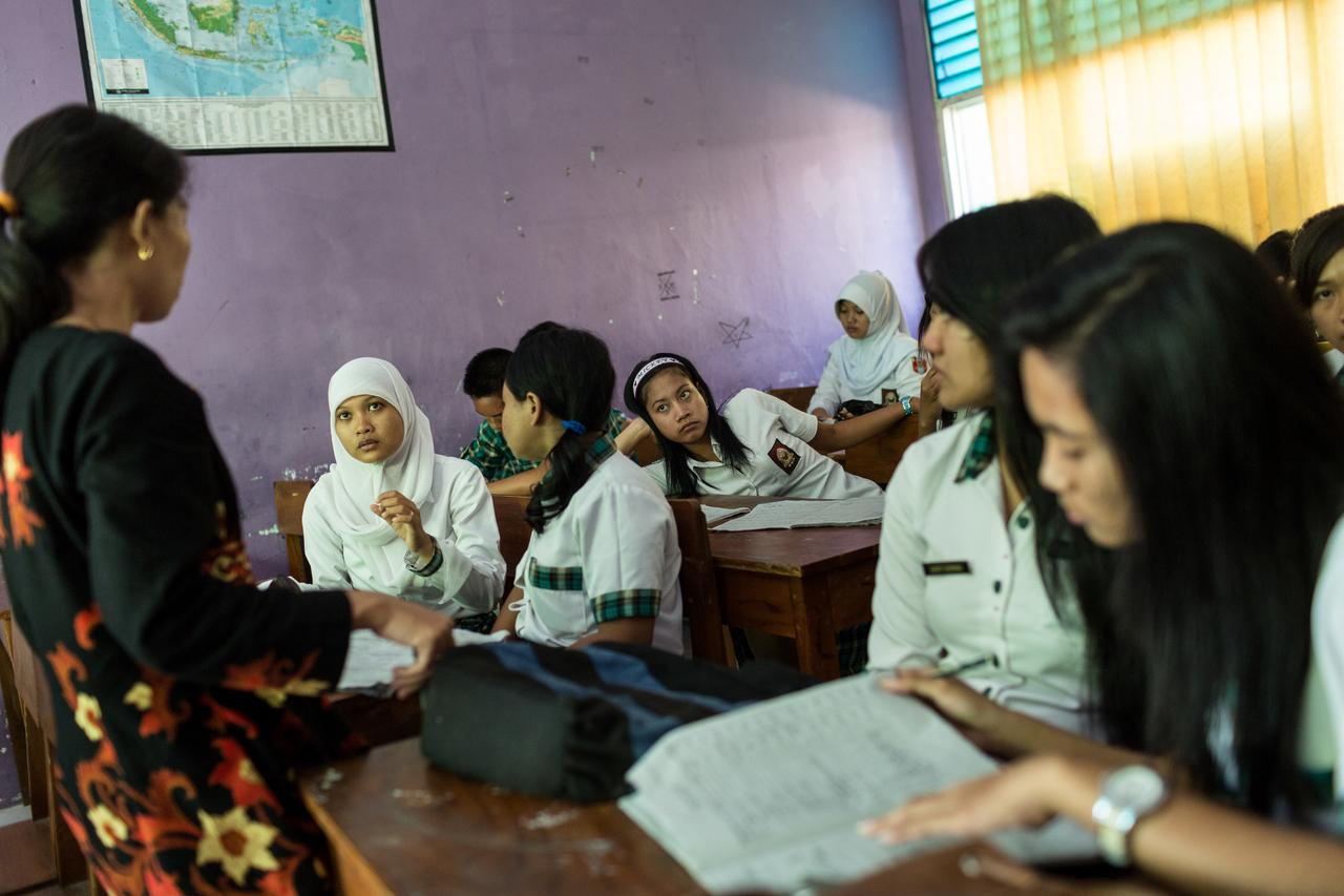 In Indonesia, Tutik's daughter, Ika, attends school. Since migrating to Singapore, Tutik has only seen Ika once for twenty-four hours. (Photo by Nicolas Axelrod)