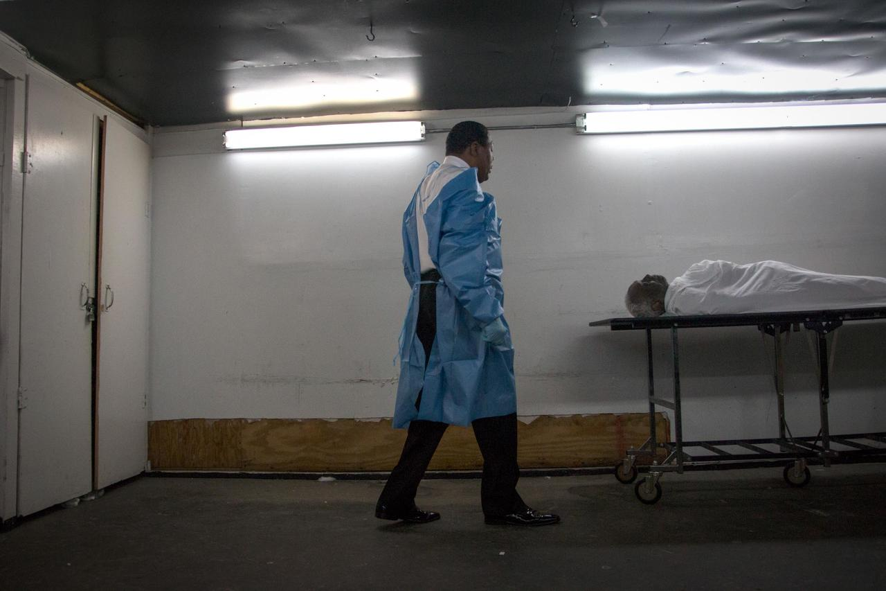 "Isaiah Owens gets ready to restore a body in the basement of his funeral home in Harlem. ""Beauty is important in death,"" he said. ""In the person's mind death has been replaced with a new life, a nice memory for people to have, to carry."""