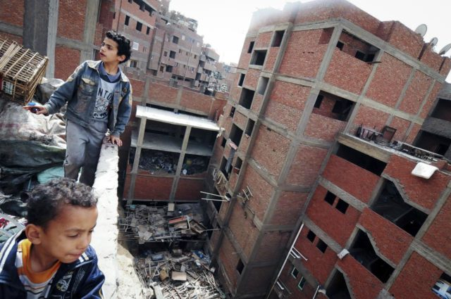 March 16, 2013, Manshiyat Naser, Egypt. Coptic children play on the rooftop of one of the many buildings inside the slum.