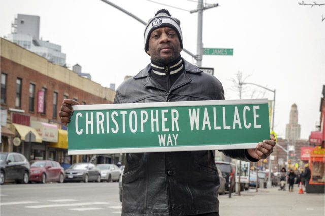 LeRoy McCarthy with a sign prototype at the corner of St. James Place and Fulton Street in Brooklyn