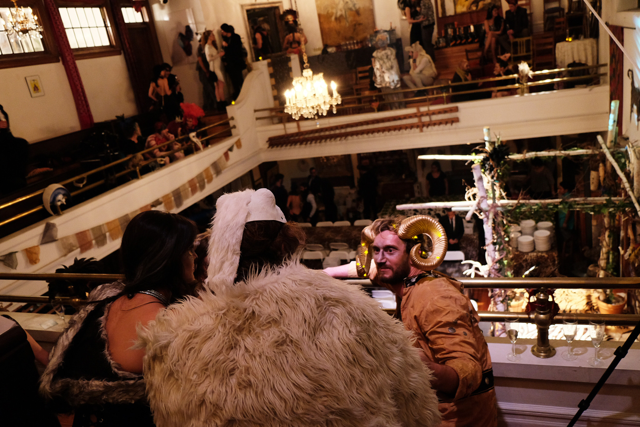 Costumed guests in the balcony of the couple's home, a former church building in Harlem.