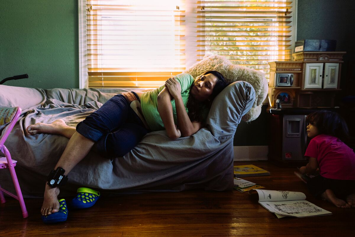 A woman and her daughter rest at the Mennonite House after being released from the detention center in Dilley.