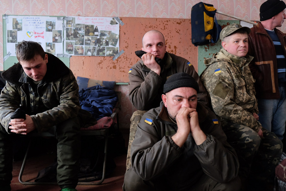 Soldiers from the 16th regiment take part in a daily meeting to talk about their fears and problems.
