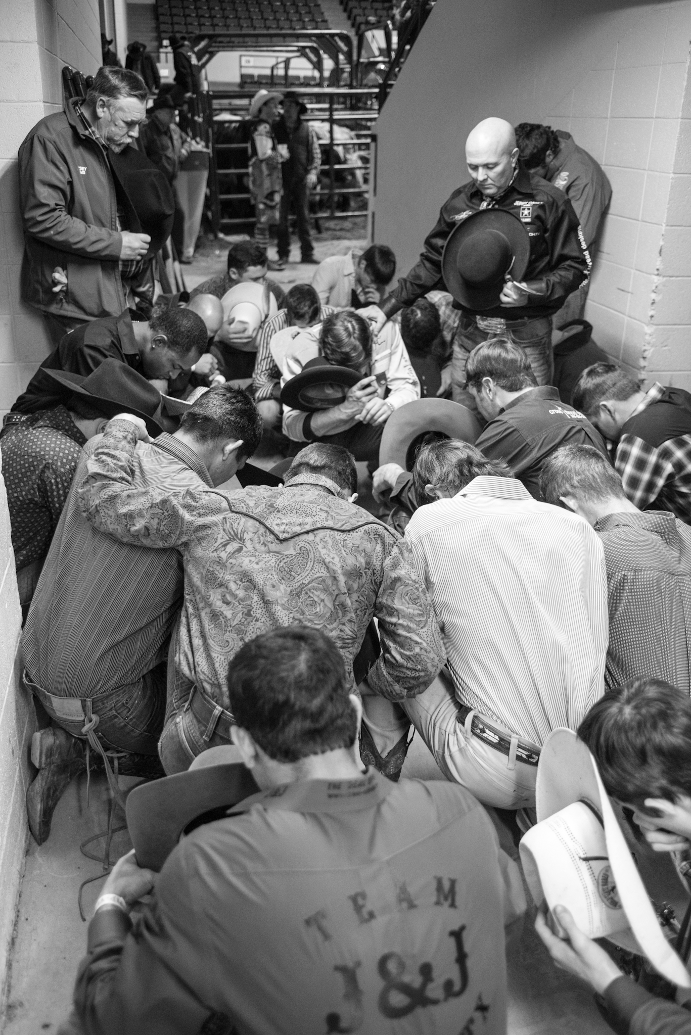 In a sport where one's life is always on the line, where so much can change in a second, bull riders are often religious men. Kneeling to pray, before and after the ride, both as groups and alone, is common.