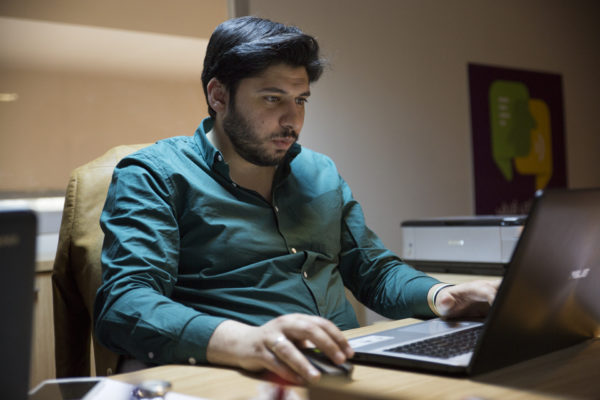 Akil, the founder of the Gherbtna and Tarjemly apps, works at his desk in the Namaa Solutions office in central Gaziantep.
