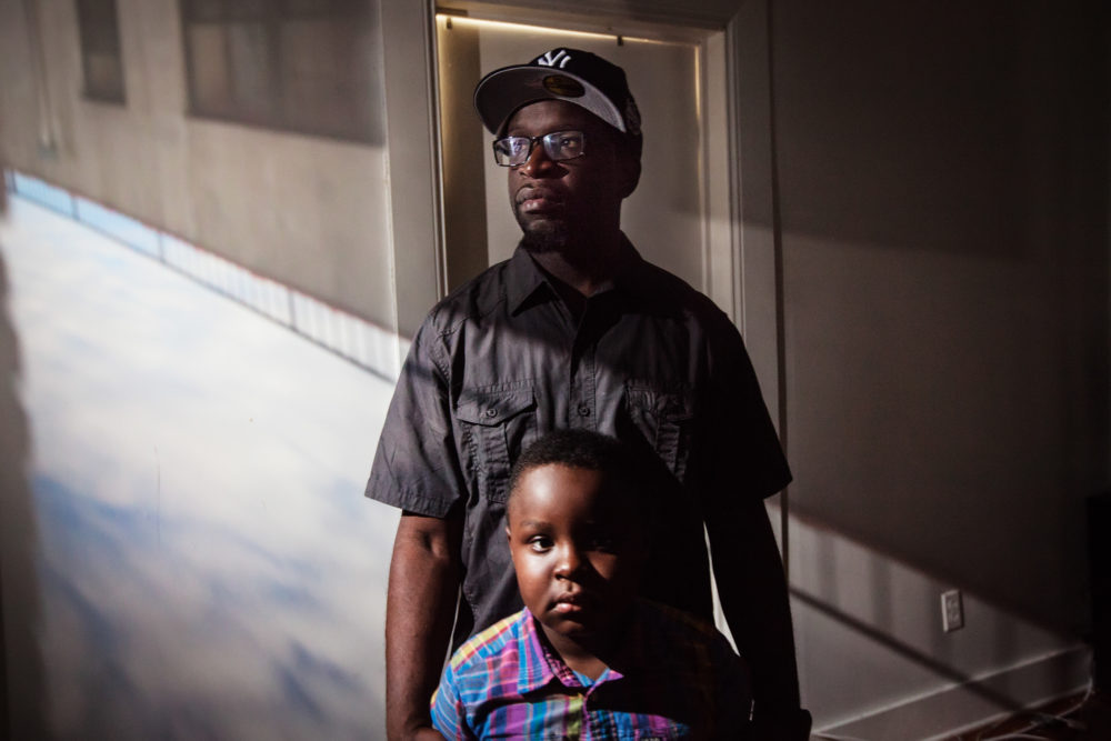 """Clifton Jerrick, 35, poses for a portrait with his son, Logan Suttor, in East New York. """"Being a father is just not a title, it's a job. It's a full time job until the day you die."""""""