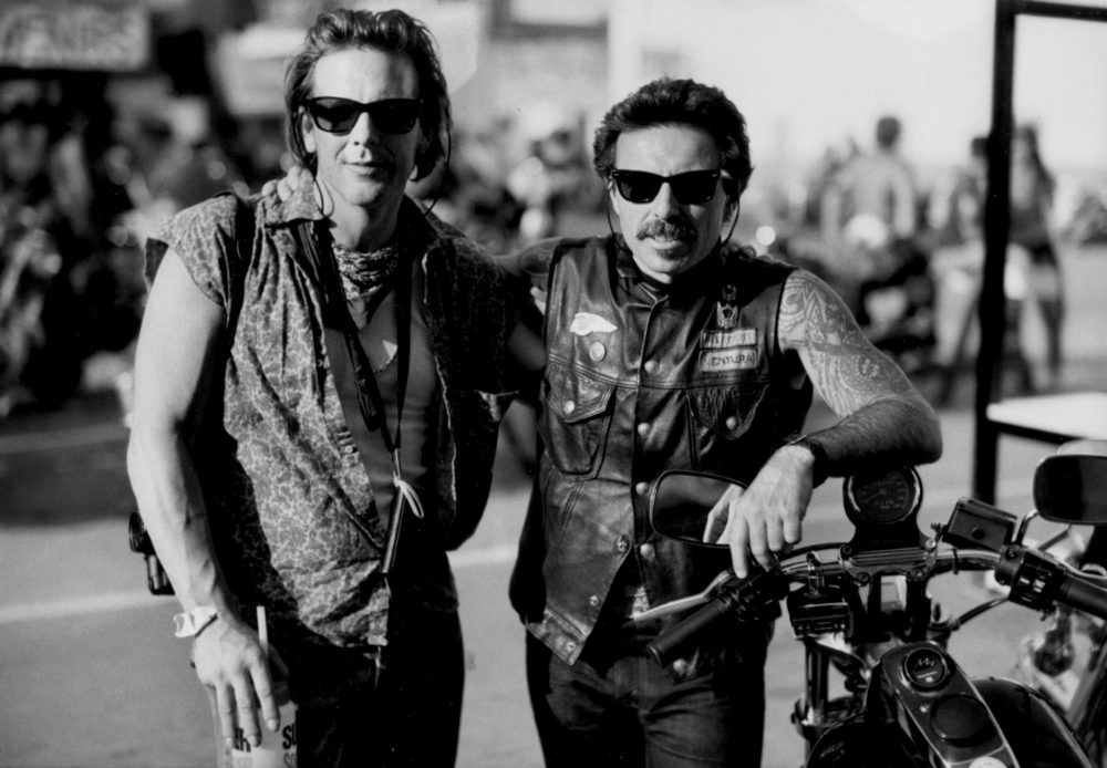 Christie poses with friend and fellow rider Mickey Rourke.