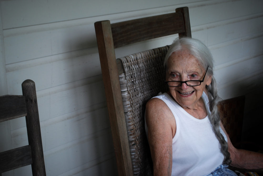 Doris Abernathy sits in a rocking chair on her back porch.