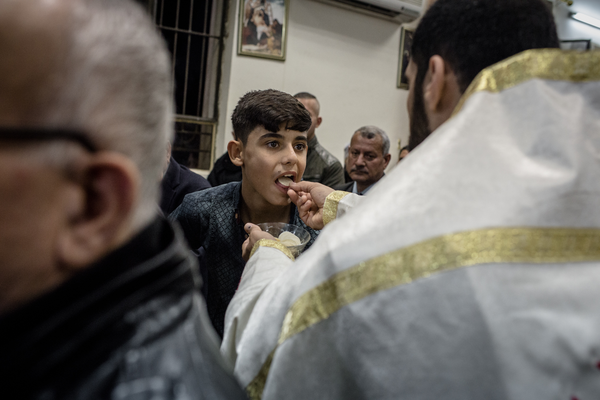 Iraqi Christians, many displaced during the capture of Mosul and its surrounding countryside by ISIS last year, take communion during a Christmas Eve mass at a church in the Ankawa neighborhood, of Erbil, Kurdistan on December 24, 2015.