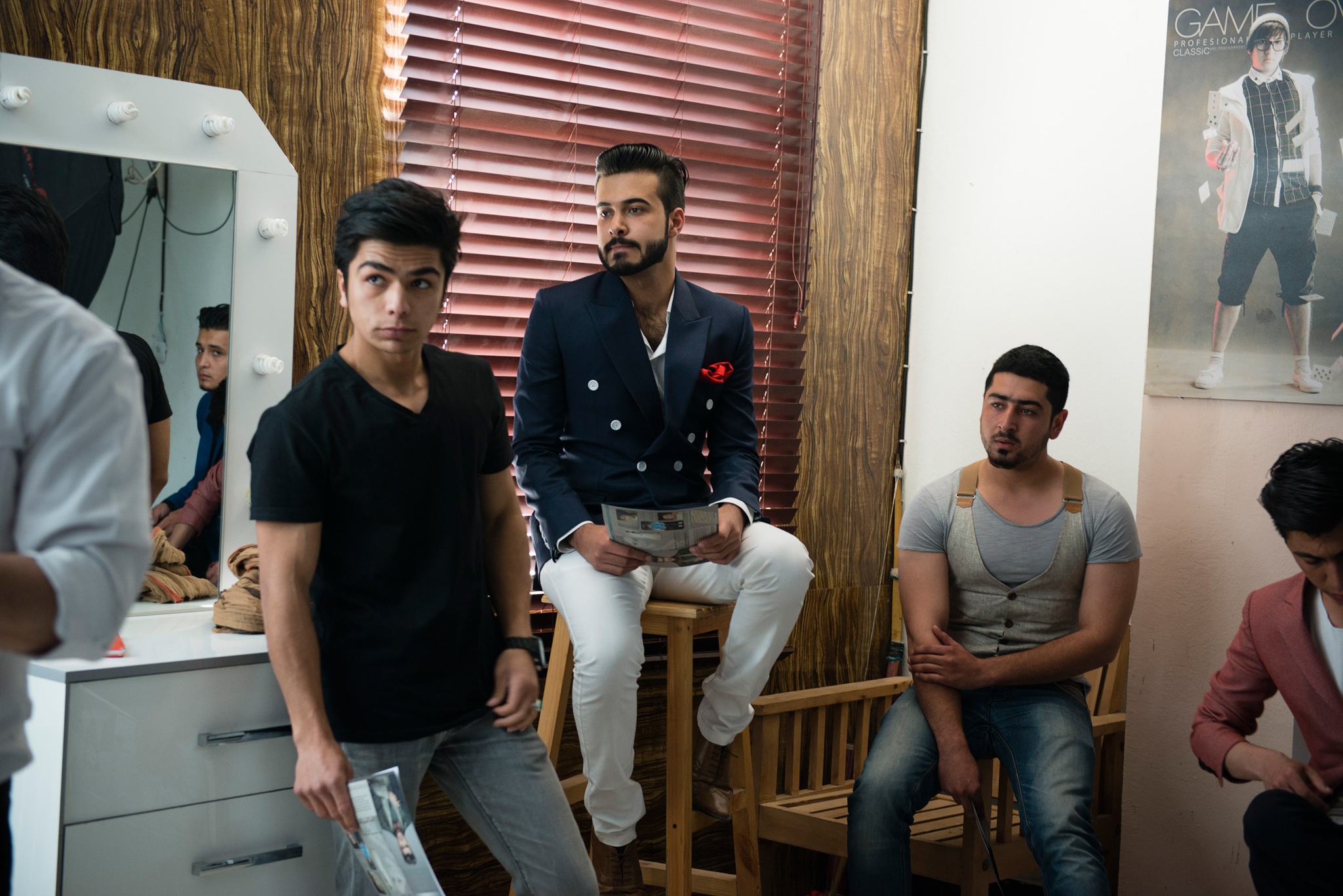 In the Karte neighborhood of Kabul, a group of young fashion photographers have come together to organize the first male modeling agency in Afghanistan. Here, young men wait their turn for a trial shoot with the agency.