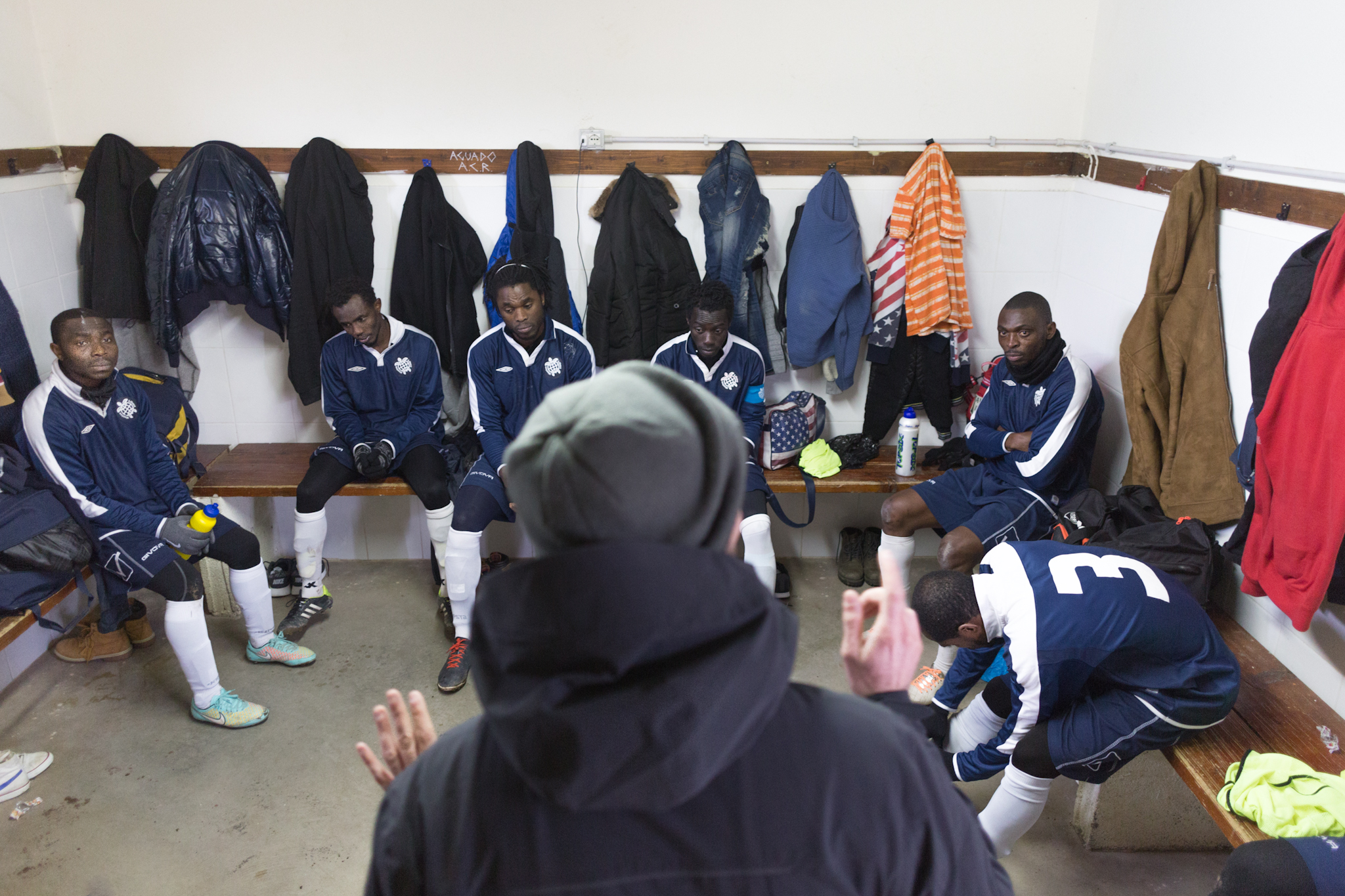 Coach Salvatore Lisciandrello (aka Toti) speaks to the team moments before a game.